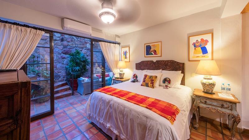 Suite 49 bedroom overlooking french doors