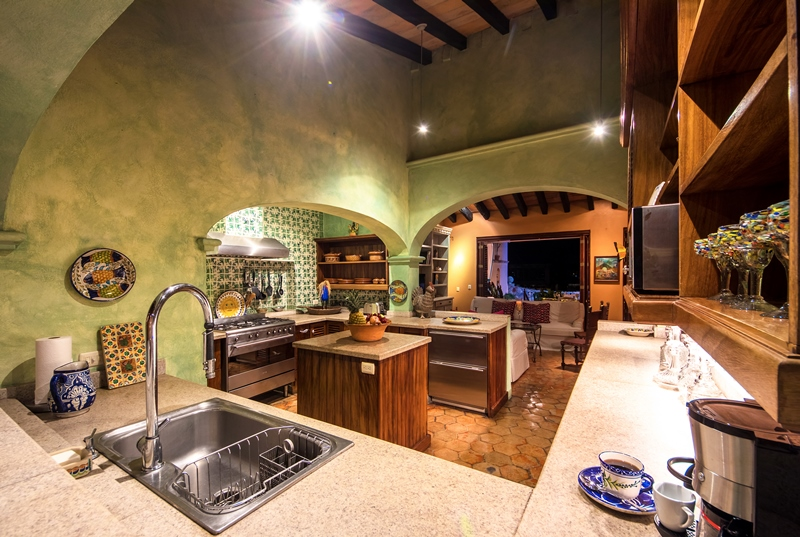 kitchen overlooking great room at night